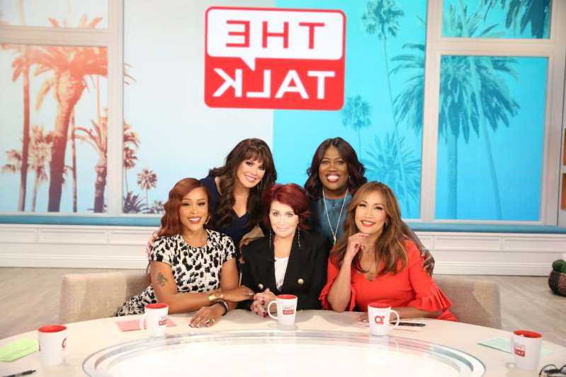 Carrie Ann Inaba, Sheryl Underwood, Sharon Osbourne, Eve sitting at a table posing for the camera: The ladies of