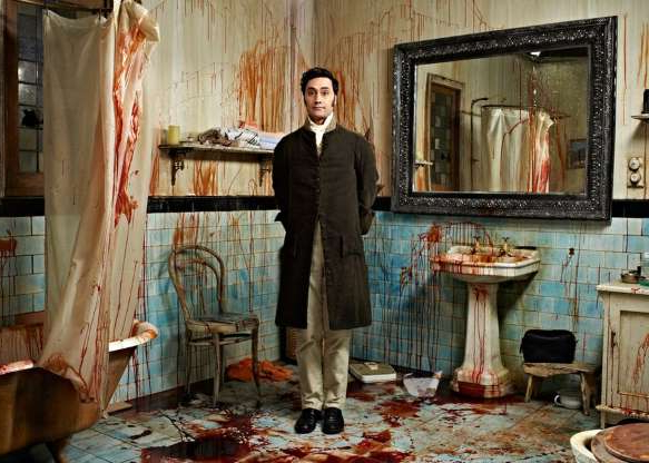 Dev Anand standing in front of a mirror posing for the camera: The New Zealand vampire comedy movie What We Do in the Shadows -- co-created by and starring Taika Waititi -- is retooled for US television on FX. Matt Berry and Kayvan Novak star.