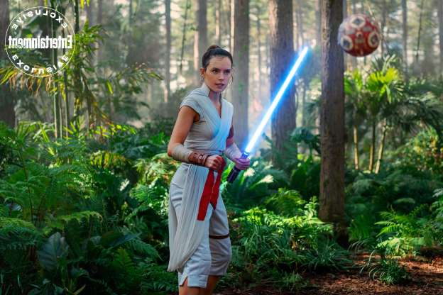 Slide 1 of 12: Rey (Daisy Ridley) faces off against a training remote.