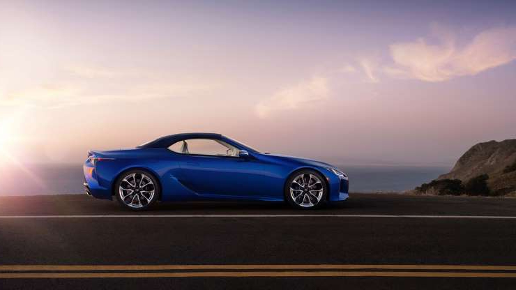 Slide 1 of 21: 2021-Lexus-LC500-Convertible-side-view.jpg