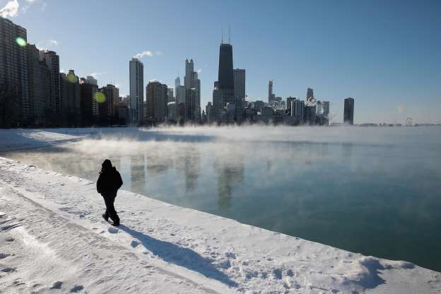 Slide 1 of 9: CHICAGO, ILLINOIS - JANUARY 30: A man takes a walk along the city's lakefront as temperature hung around -20 degrees on January 30, 2019 in Chicago, Illinois. Businesses and schools have closed, Amtrak has suspended service into the city, more than a thousand flights have been cancelled and mail delivery has been suspended as the city copes with record-setting low temperatures.  (Photo by Scott Olson/Getty Images)