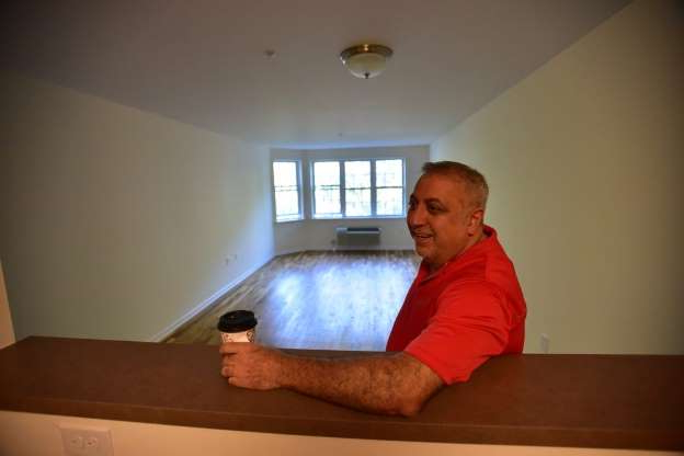 Slide 11 of 12: Fred Daibes, a local developer in Edgewater, inside of an affordable housing apartment in Edgewater in 2016.