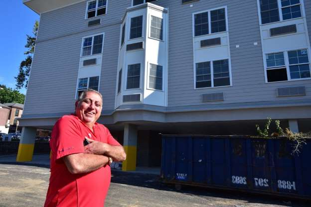 Slide 12 of 12: Fred Daibes, a local developer in Edgewater, poses for a photo by a affordable housing building on Winterburn place in Edgewater in 2016.