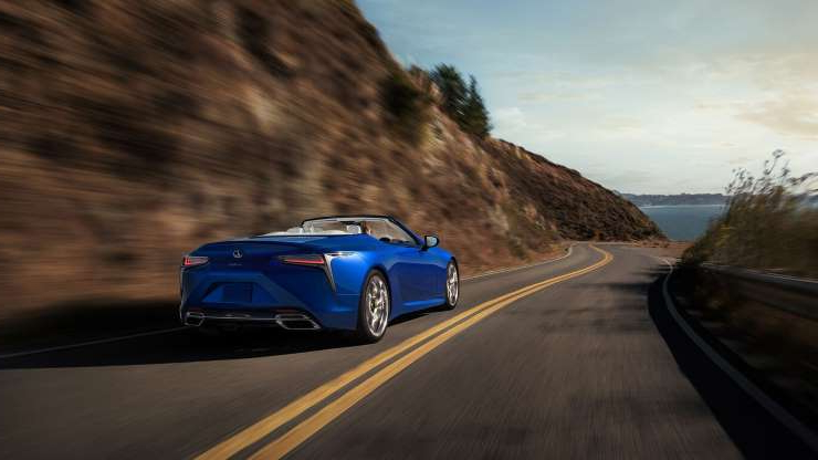 Slide 3 of 21: 2021-Lexus-LC500-Convertible-rear-three-quarter-in-motion-2.jpg