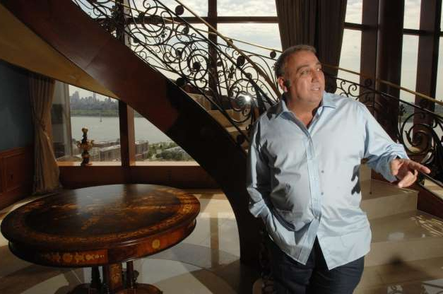 Slide 7 of 12: Fred Daibes, Edgewater-based developer, and largest shareholder in troubled Mariner's Bank, stands by the circular staircase in his very large home within the St. Moritz in Edgewater in 2012.   Carmine Galasso/Staff Photographer.