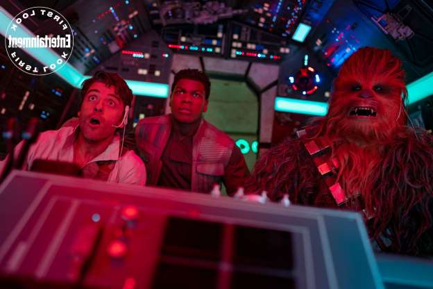Slide 8 of 12: Chewie, Poe, and Finn take a ride in the Millennium Falcon.