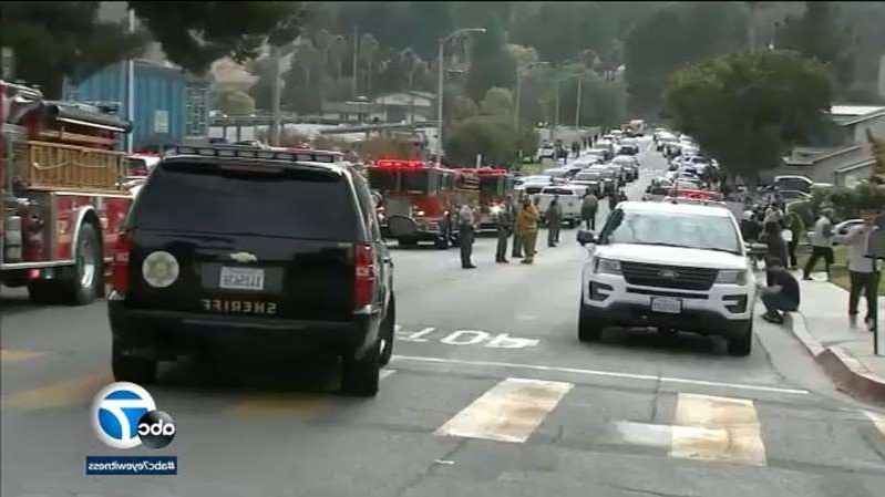 a car driving on a city street filled with lots of traffic: Weapon used in Saugus High shooting was 'kit gun,' authorities say
