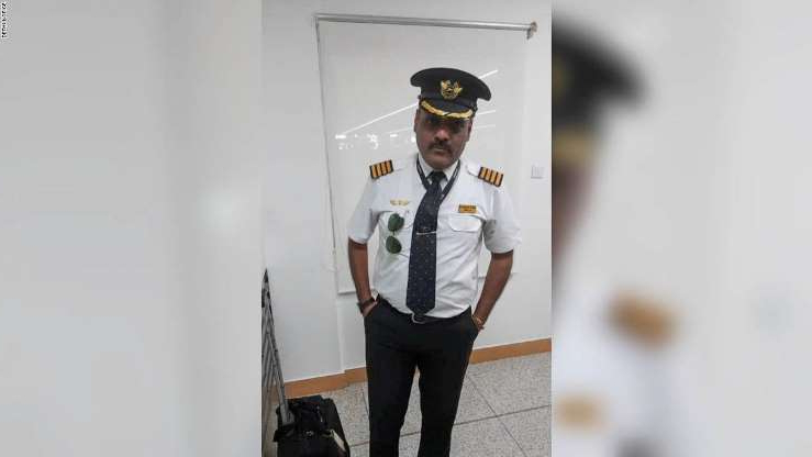 a man wearing a hat: Police say Rajan Mahbubani confessed to regularly dressing up as a pilot to get preferential treatment.
