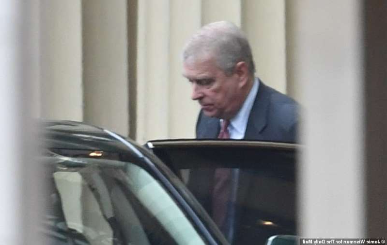 a man wearing a suit and tie: Prince Andrew arrives at Buckingham Palace and gets out of his Bentley around noon today before heading to a Pitch@Palace meeting in Dubai after the Queen sacked him from royal duties