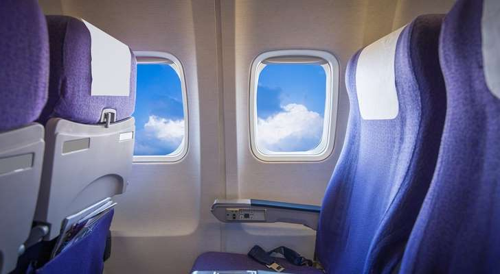 a passenger seat of a car: plane, seats, interior