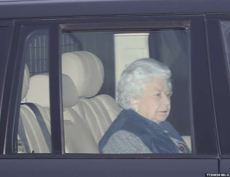 a passenger seat of a car window: The Queen leaves Buckingham Palace this afternoon after carrying out investitures and heads to Windsor amid the furious backlash about her son's friendship with Epstein
