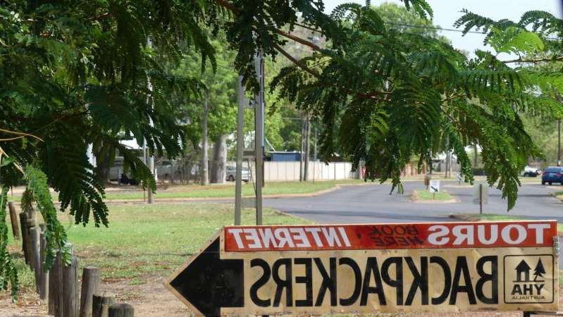a sign on the side of a tree: Police raided the Kununurra YHA on Wednesday, after Border Force officials intercepted drugs allegedly sent from the Netherlands. (ABC Kimberley: Rebecca Nadge)