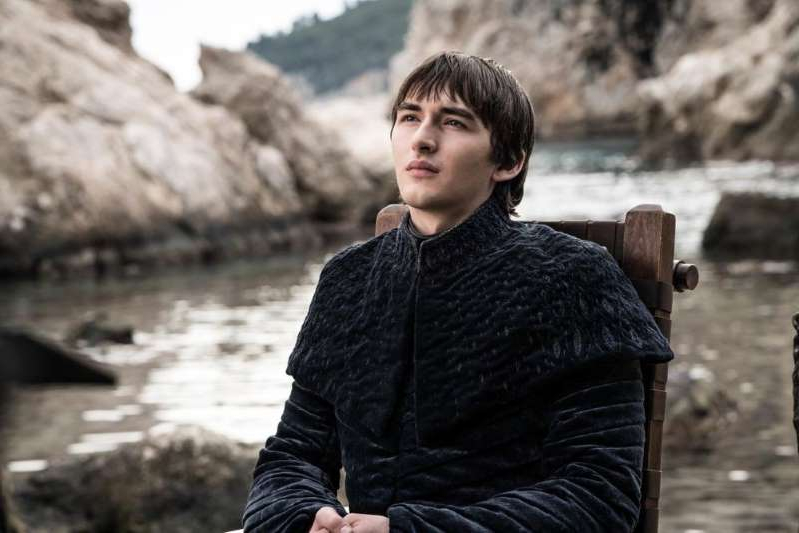 a young boy standing in front of a rock: Isaac Hempstead-Wright as Bran Stark | Helen Sloan/HBO