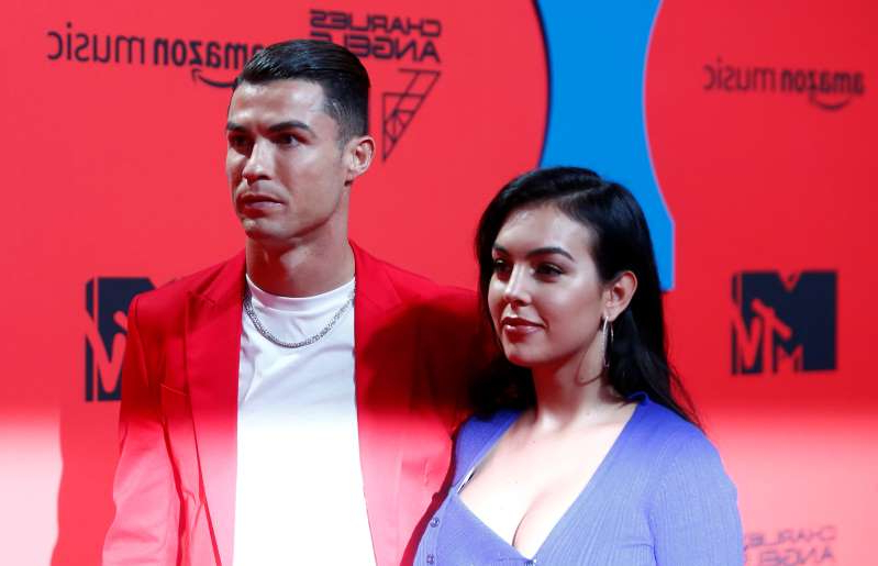 Cristiano Ronaldo and Georgina Rodriguez pose on a red carpet as they arrive at the 2019 MTV Europe Music Awards at the FIBES Conference and Exhibition Centre in Seville, Spain, November 3, 2019. REUTERS/Jon Nazca