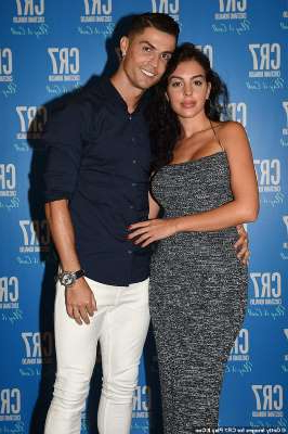 Monica Bellucci, Cristiano Ronaldo are posing for a picture: Denied: Cristiano Ronaldo has shot down reports that he wed his long-term girlfriend Georgina Rodríguez in a low-key ceremony in Morocco . Pictured together in September