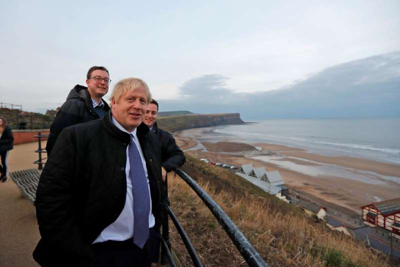 Prime Minister Boris Johnson looks out over the sea during a General Election campaign trail stop in Saltburn-by-the-Sea.