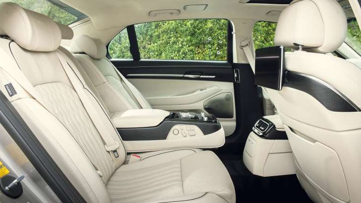 Slide 1 of 13: 2020-Genesis-G90-rear-seat-side.jpg