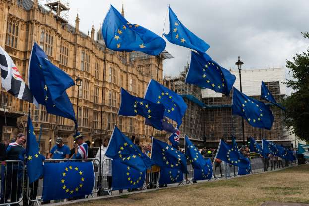 Slide 10 of 60: Anti-Brexit protesters demonstrate outside the Houses of Parliament as MPs return to their duties after prorogation has been quashed by the Supreme Court judges on 25 September, 2019 in London, England. The House of Commons reconvenes today following the Supreme Court judgement that the five-week prorogation of the UK parliament by prime minister Boris Johnson in the run-up to the EU departure date at the end of October was unlawful. (Photo by WIktor Szymanowicz/NurPhoto via Getty Images)