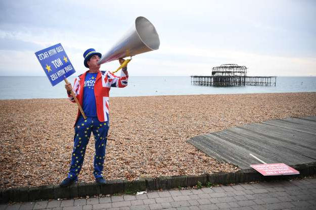Slide 11 of 60: BRIGHTON, ENGLAND - SEPTEMBER 22: Pro-remain campaigner Steve Bray protests on Brighton Beach on day 1 of the Labour Party conference on September 22, 2019 in Brighton, England. (Photo by Leon Neal/Getty Images)