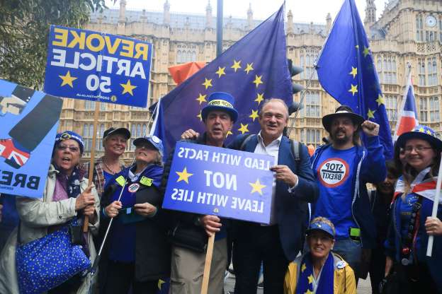 Slide 15 of 60: Liberal Democrat MP, Ed Davey poses with Steve Bray of (SODEM) Stand of Defiance European Movement and pro remain protesters outside Parliament (Photo credit should read Amer Ghazzal / Barcroft Media via Getty Images)