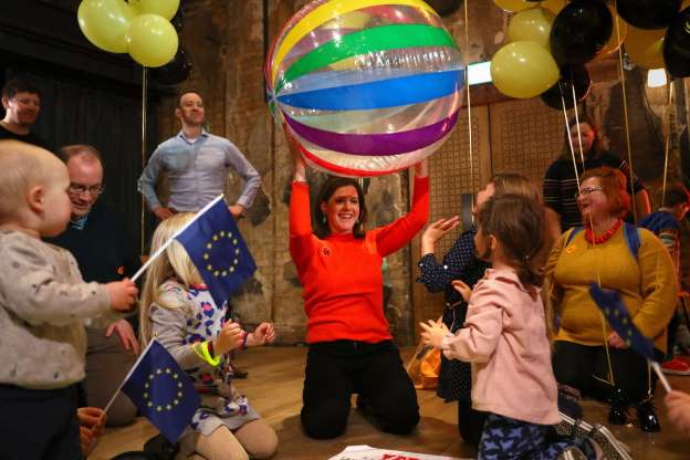 Slide 21 of 31: Liberal Democrats leader Jo Swinson playing with children at the Battersea Arts Centre in Lavender Hill, while on the General Election campaign trail in London. (Photo by Aaron Chown/PA Images via Getty Images)