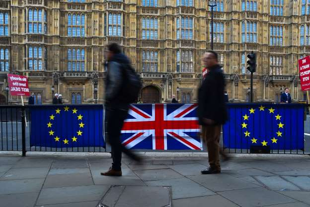 Slide 29 of 60: People walk past EU and Union flags, outside the Houses of Parliament, London on April 1, 2019. Chief Whip Julian Smith was critic with the Cabinet's post-election strategy. (Photo by Alberto Pezzali/NurPhoto via Getty Images)
