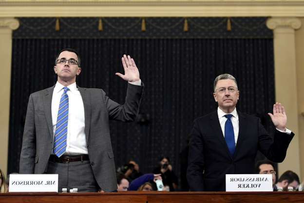 Slide 31 of 56: Ambassador Kurt Volker, left, former special envoy to Ukraine, and Tim Morrison, a former official at the National Security Council are sworn in to testify before the House Intelligence Committee on Capitol Hill in Washington, Tuesday, Nov. 19, 2019, during a public impeachment hearing of President Donald Trump's efforts to tie U.S. aid for Ukraine to investigations of his political opponents.(AP Photo/Susan Walsh)