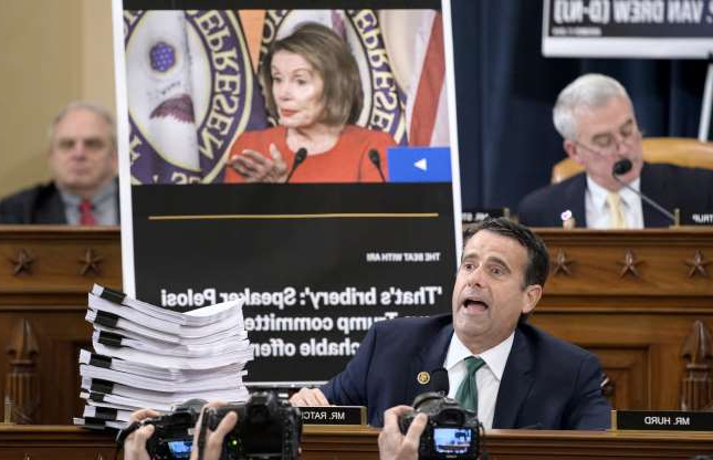 Slide 34 of 56: Rep. John Ratcliffe, R-Texas, uses a poster of House Speaker Nancy Pelosi as he questions National Security Council aide Lt. Col. Alexander Vindman, as he testifies before the House Intelligence Committee on Capitol Hill in Washington, Tuesday, Nov. 19, 2019,