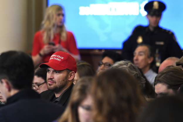 Slide 37 of 56: People in the audience listen as Jennifer Williams, an aide to Vice President Mike Pence, and National Security Council aide Lt. Col. Alexander Vindman, testify before the House Intelligence Committee on Capitol Hill in Washington, Tuesday, Nov. 19, 2019,