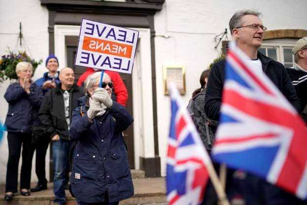 Slide 40 of 60: MANSFIELD, ENGLAND - MARCH 23:  'March to Leave' walkers gather in the village of  Linby for their walk to Beeston, Nottinghamshire on March 23, 2019 in Mansfield, England. The 'March to Leave' walk is making its way to London in 14 stages arriving on March 29, the original date for the UK to leave the European Union. (Photo by Christopher Furlong/Getty Images)