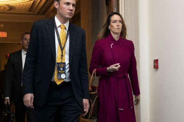 Slide 44 of 56: Jennifer Williams, an aide to Vice President Mike Pence, arrives to testify before the House Intelligence Committee on Capitol Hill in Washington, Tuesday, Nov. 19, 2019, during a public impeachment hearing of President Donald Trump's efforts to tie U.S. aid for Ukraine to investigations of his political opponents. (AP Photo/Manuel Balce Ceneta)