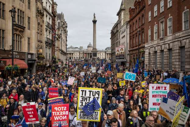 Slide 45 of 60: LONDON, UNITED KINGDOM - MARCH 23: Protesters take part in the Put It To The People March on Whitehall on March 23, 2019 in London, England. Thousands of protesters gathered in central London today to take part in the Put It To The People March. The march from Park Lane to Parliament Square was organised by the Peoples Vote campaign and is calling for a public vote on the Governments final Brexit deal. (Photo by Dan Kitwood/Getty Images)