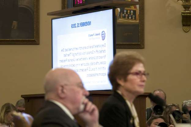Slide 48 of 56: A tweet from President Donald Trump is displayed as former U.S. Ambassador to Ukraine Marie Yovanovitch testifies before the House Intelligence Committee on Capitol Hill in Washington, Friday, Nov. 15, 2019, during the second public impeachment hearing of President Donald Trump's efforts to tie U.S. aid for Ukraine to investigations of his political opponents.