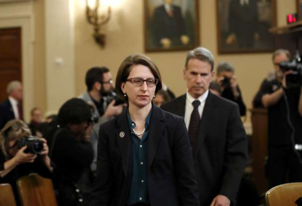 Slide 5 of 56: Deputy Assistant Secretary of Defense Laura Cooper, right, and State Department official David Hale, arrive to testify before the House Intelligence Committee on Capitol Hill in Washington, Wednesday, Nov. 20, 2019,