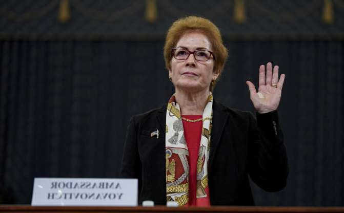 Slide 50 of 56: Marie Yovanovitch, former U.S. ambassador to Ukraine, is sworn in to testify before a House Intelligence Committee hearing as part of the impeachment inquiry into U.S. President Donald Trump on Capitol Hill in Washington, U.S., November 15, 2019. REUTERS/Jonathan Ernst
