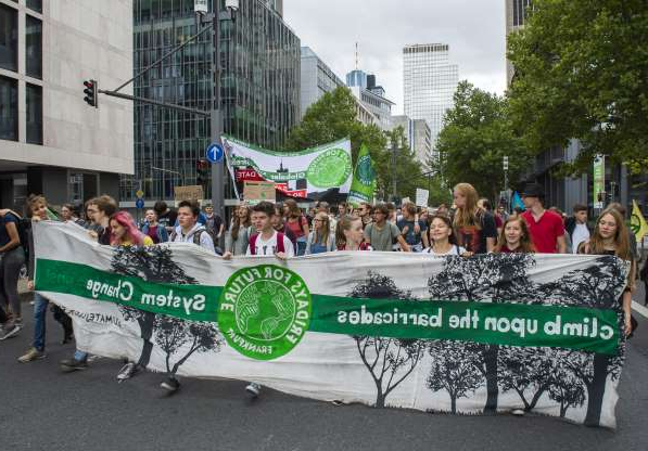 Slide 7 of 14: 13 September 2019, Hessen, Frankfurt/Main: Participants of a Fridays for Future demonstration walk through Frankfurt with protest signs and banners. On the occasion of the IAA, demonstrations will be held on the topics of traffic turnaround and sustainable mobility. Photo: Lennart Stock/dpa (Photo by Lennart Stock/picture alliance via Getty Images)