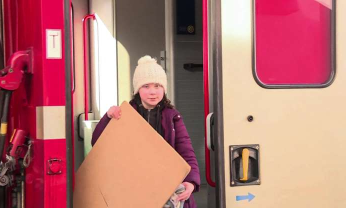 Slide 9 of 14: An image grab taken from a video from AFPTV on January 23, 2019 shows Swedish youth climate activist Greta Thunberg arriving by train during the World Economic Forum (WEF) annual meeting in Davos, eastern Switzerland. - Arriving by train -- rather than a more polluting plane -- to Davos on January 23, 2019, Thunberg, the Swedish 16-year-old, has galvanised protests by high-schoolers in Europe, Japan and the United States demanding stronger government action to fight global warming. (Photo by Agnès PEDRERO and Eloi ROUYER / AFPTV / AFP) (Photo credit should read AGNES PEDRERO,ELOI ROUYER/AFP/Getty Images)