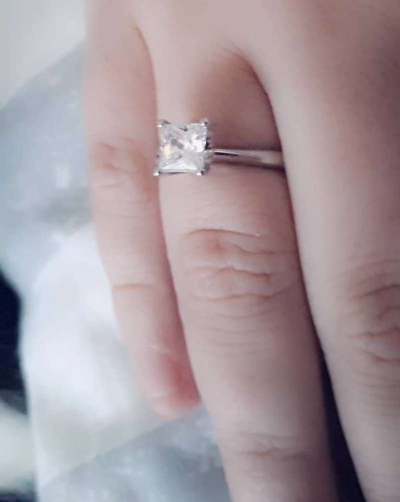 a close up of a hand: Shannon Lynch wearing her engagement ring from Ashley. [Photo: SWNS]