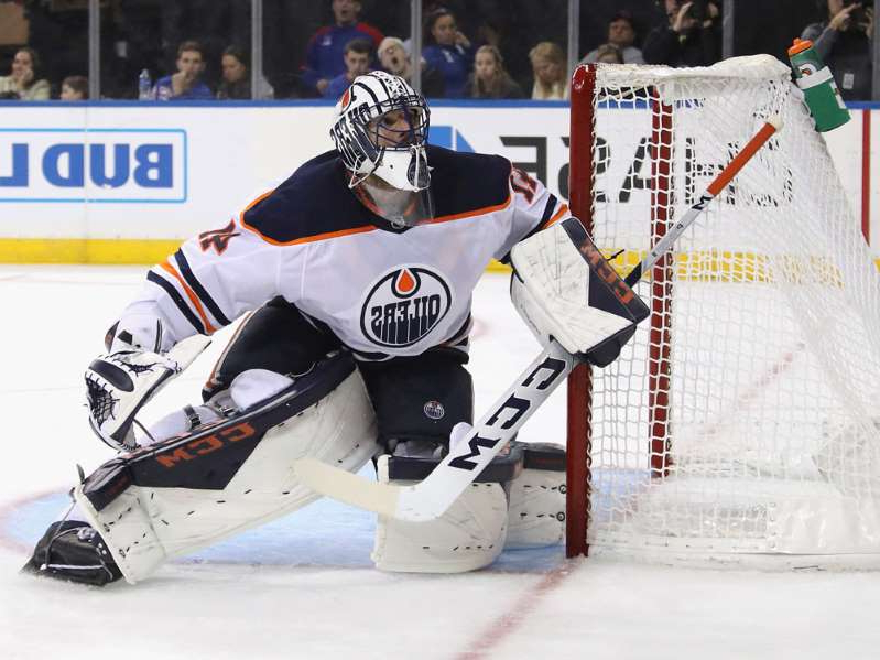 a person skiing on the snow: Edmonton Oilers goalie Mike Smith during NHL action