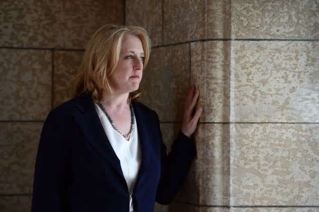 a person standing in front of a building: Conservative deputy leader Lisa Raitt said she and her husband hope to provide similar inspiration to families struggling with early-onset Alzheimer's.