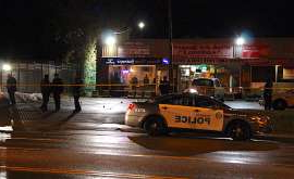 a truck on a city street at night: The shooting happened outside a bar in a plaza on Lawrence Avenue East at Susan Street.