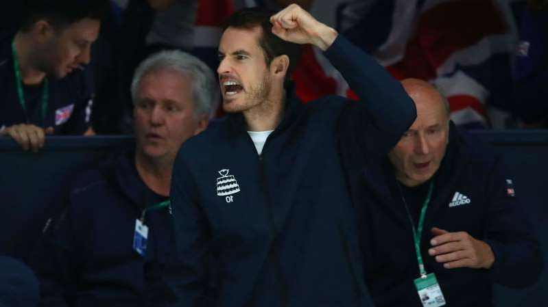 Andy Murray standing in front of a crowd: Andy Murray cheered on his team-mates during Friday's tie with Kazakhstan.