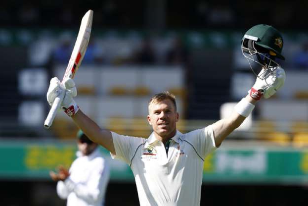 David Warner getting ready to hit the ball: Australia's David Warner celebrates after scoring 100 runs during their cricket test match against Pakistan in Brisbane, Australia, Friday, Nov. 22, 2019. (AP Photo/Tertius Pickard)
