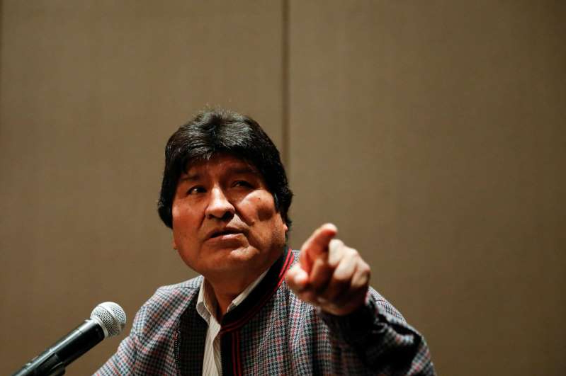 Evo Morales wearing a suit and tie: Former Bolivian President Evo Morales holds a news conference in Mexico City