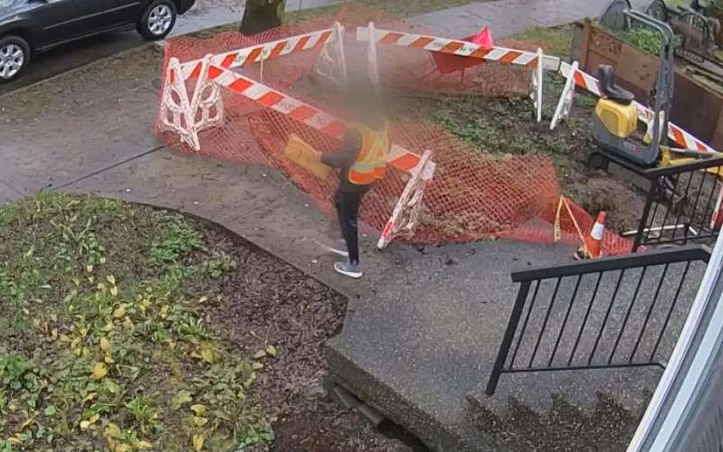 Security camera footage shows a delivery worker walking away from an East Vancouver home with a package the homeowner says was notified as delivered.