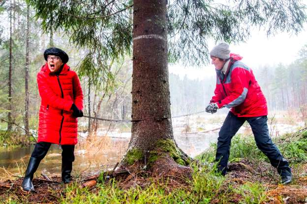 Slide 20 of 31: Mayor of Oslo Marianne Borgen (L) and Ruth Bush, Councillor of London's Westminster district, are sawing down the tree which will stand at Trafalgar Square in London this Christmas, on November 19, 2019 in a forest in Oslo. - This year´s tree is a spruce, 24 meters high and it has lived about 80 years in the woods east of Oslo. (Photo by Hakon Mosvold LARSEN / NTB Scanpix / AFP) / Norway OUT (Photo by HAKON MOSVOLD LARSEN/NTB Scanpix/AFP via Getty Images)