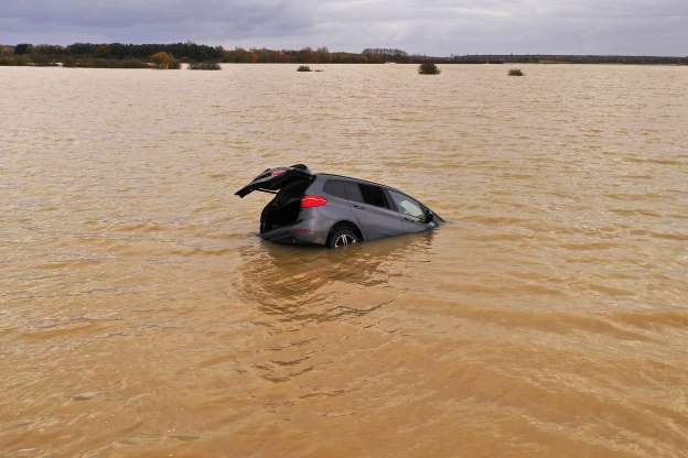 Slide 22 of 31: LINCOLN, ENGLAND - NOVEMBER 15: A car is seen part submerged in floodwater, at Bardney, near Lincoln, after the Barlings Eau broke its banks on November 15, 2019 in Lincoln, England.  Over 1,500 acres of land between six and 10 feet deep has been flooded after this weeks torrential rain causing floods across the UK. (Photo by Christopher Furlong/Getty Images)