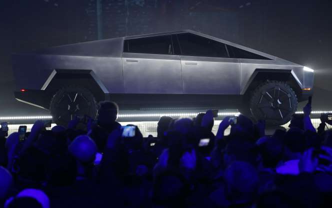 The Tesla Cybertruck is unveiled at Tesla's design studio Thursday, Nov. 21, 2019, in Hawthorne, Calif. CEO Elon Musk is taking on the workhorse heavy pickup truck market with his latest electric vehicle. (AP Photo/Ringo H.W. Chiu)