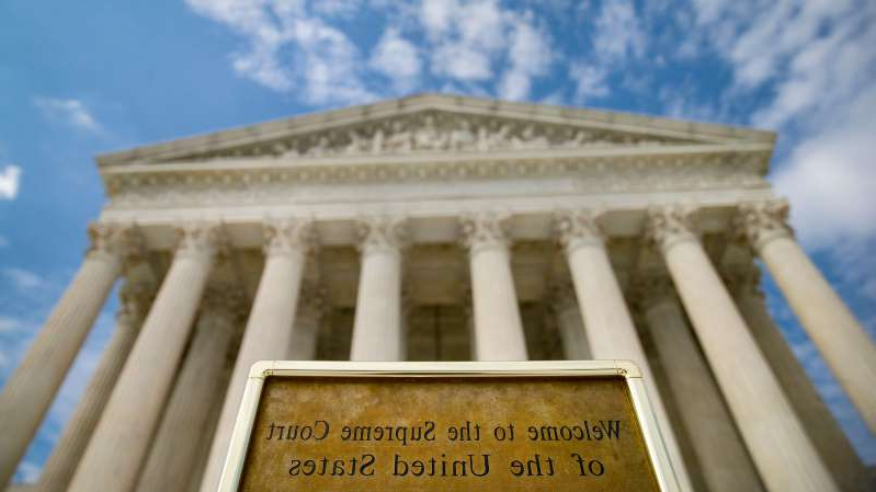 "a close up of a bench in front of a building: ""This court — not a lower federal court — should decide,"" the Justice Department said in a brief, ""whether the type of intrusion on the presidency at issue in this case is permissible."""