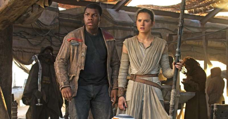 Daisy Ridley, John Boyega standing next to a suitcase: J.J. Abrams responds to George Lucas' criticism of 'The Force Awakens'